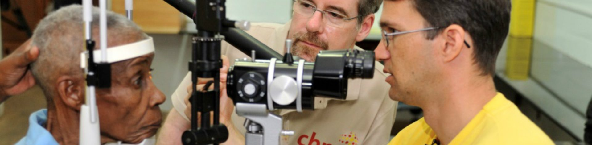 Heiko from CBM supported project in Tanzania examining someone's sight for glaucoma.