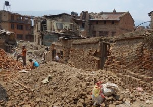 People standing on rubble following Nepal earthquake