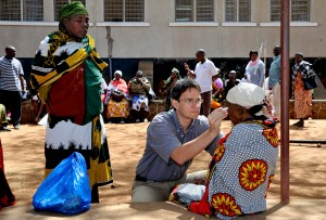 Heiko from CBM supported project in Tanzania examining someone's sight for glaucoma on a community outreach.