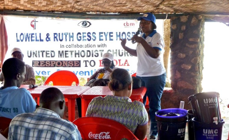 CBM together with UMC speaking to group of people about safety measure against Ebola in Sierra Leone .