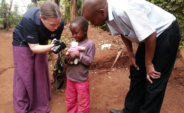 Laura, CBM Programme Manager for East Africa showing Vaileth photos on the camera.