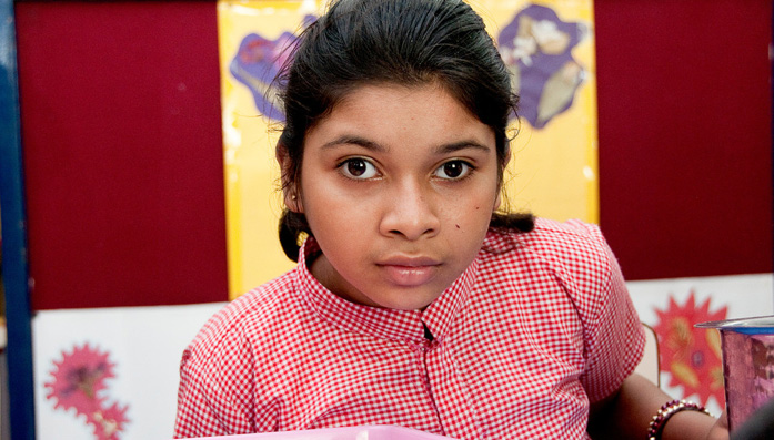 Anjali sits at the BPA rehabilitation centre where she receives treatment for visual impairment and fits caused by a severe contusion that she was born with.