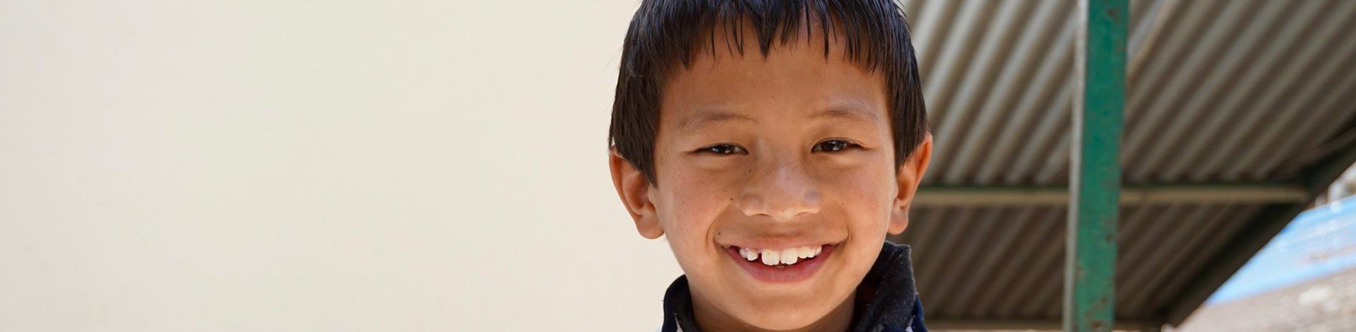 Bijaya smiling as he was given a prosthetic leg so he can walk.
