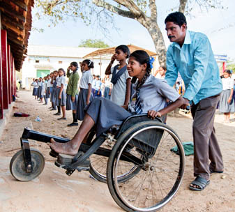Shilpa being pushed in her wheelchair into the inclusive school.
