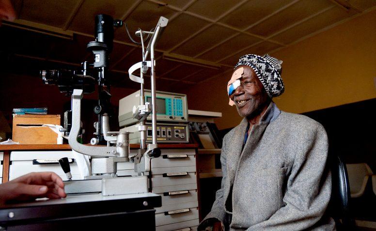 Foday having a post check up by John Buchan following cataract surgery.