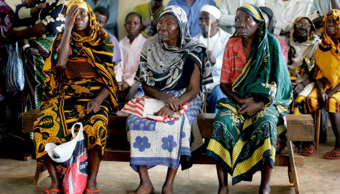 Three unidentified women having their sight tested at a CCBRT run outreach clinic in Lugoba in the Tanga Region of Tanzania.