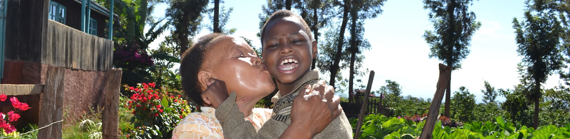 Alice kisses her grandaughter, Alice Igoki group with her granddaughter Nkirote, Kenya