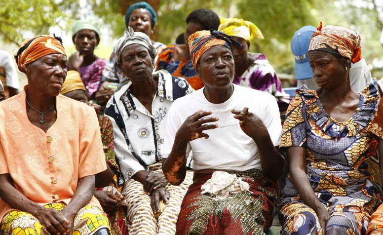 Women sitting together at a self-help group for people with disabilities and their family members.