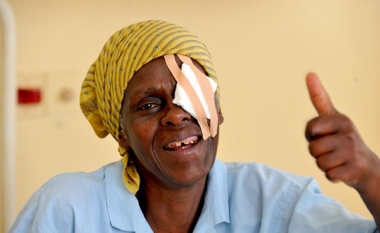 Joyce Simon Kaaya has bilateral cataracts and is sticking her thumb up after her operation.