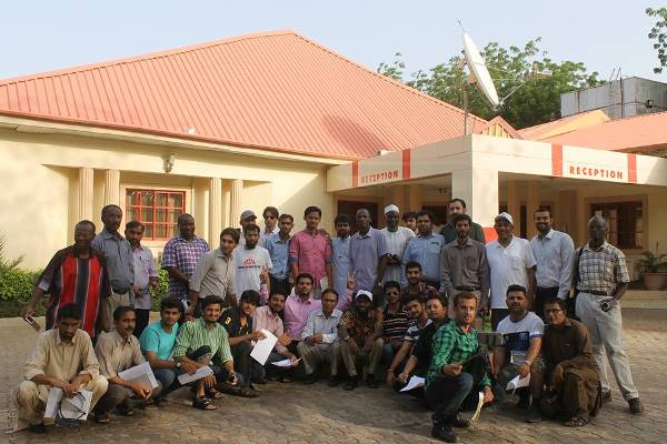 CBM Trachoma mapping team in Pakistan standing together smiling.