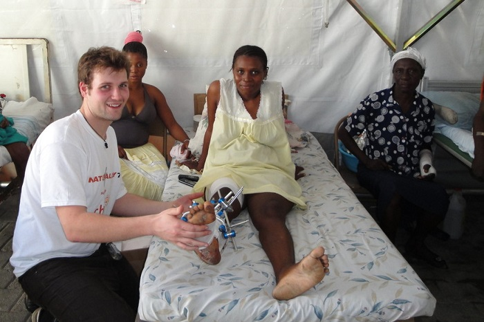 David Young (Physiotherapist) treats a woman after the Haiti earthquake in 2010