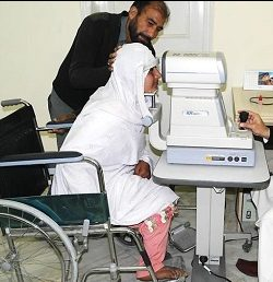 Haseena, a wheelchair user, at an eye examination