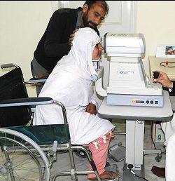 Haseena, a wheelchair user, at an eye examination