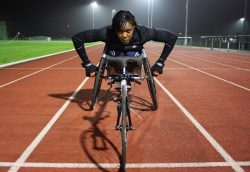 Anne Wafula Strike on her tricycle before a race.
