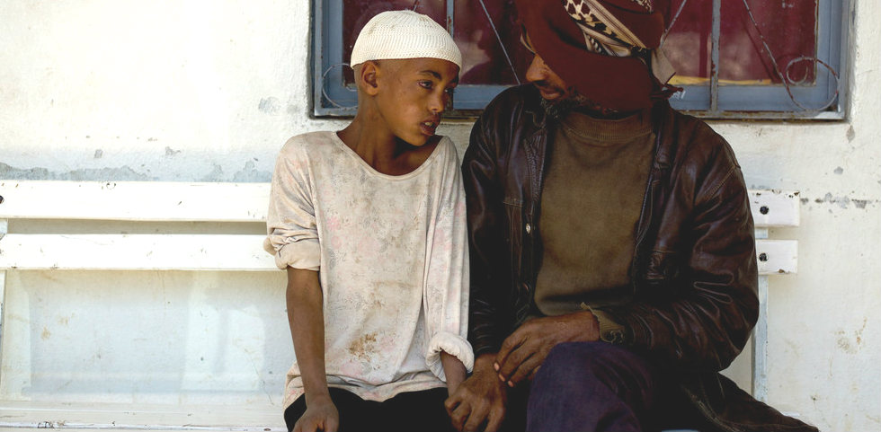 12 year old Nasire with his father