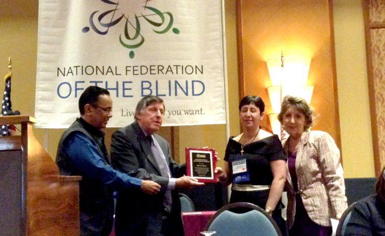 Lord Low of Dalston presents the award to Rima Canawati