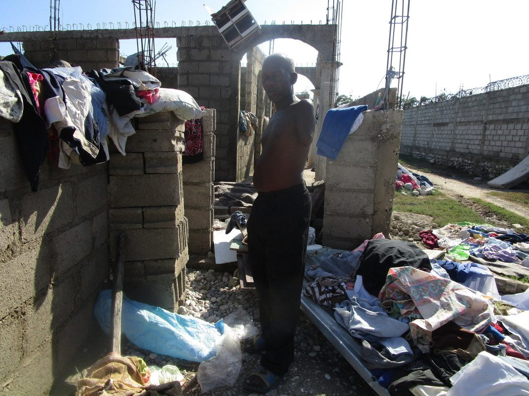 Disabled man stands in the wreckage of his home