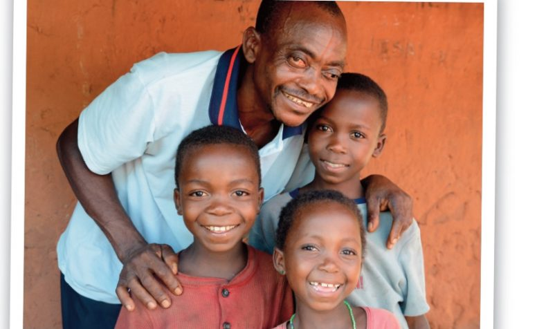 Vincent and his children, who are protected from River Blindness thanks to medicine distributed by CBM.