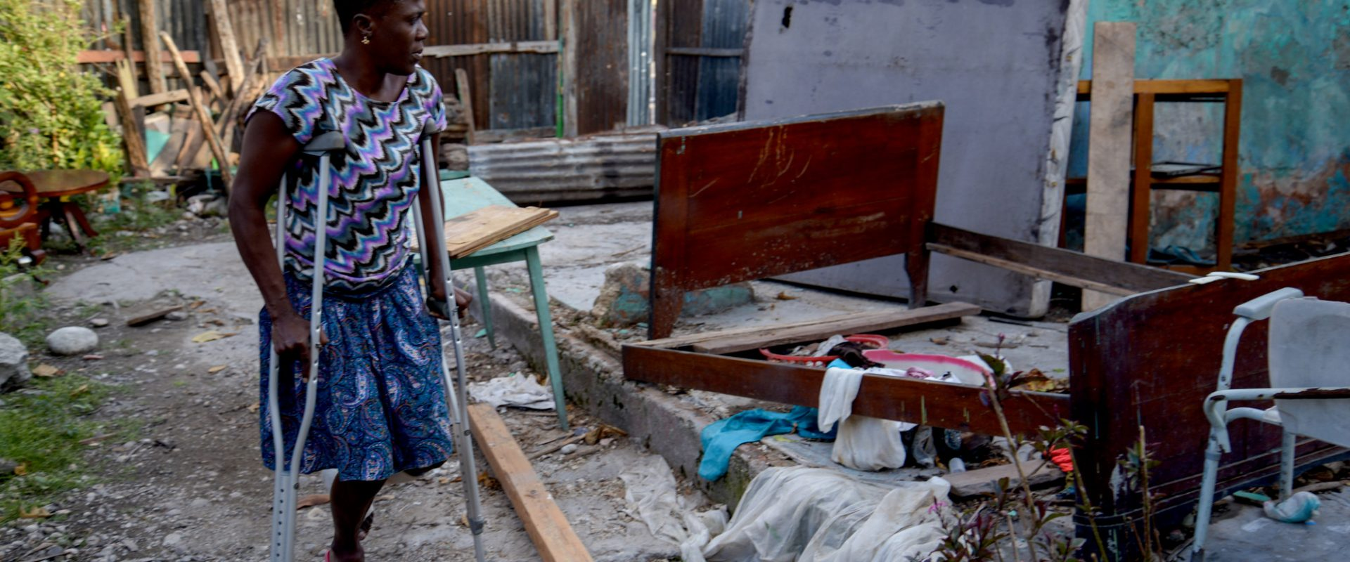 Hurricane Matthew - Haiti - October 2016. Communications visit December 2016  .Marie Ange at her damaged house in Les Cayes, Haiti  .Read full story in CBM Media Database.