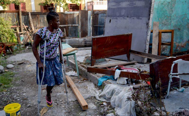 Hurricane Matthew - Haiti - October 2016. Communications visit December 2016  .Marie Ange at her damaged house in Les Cayes, Haiti  .Read full story in CBM Media Database.