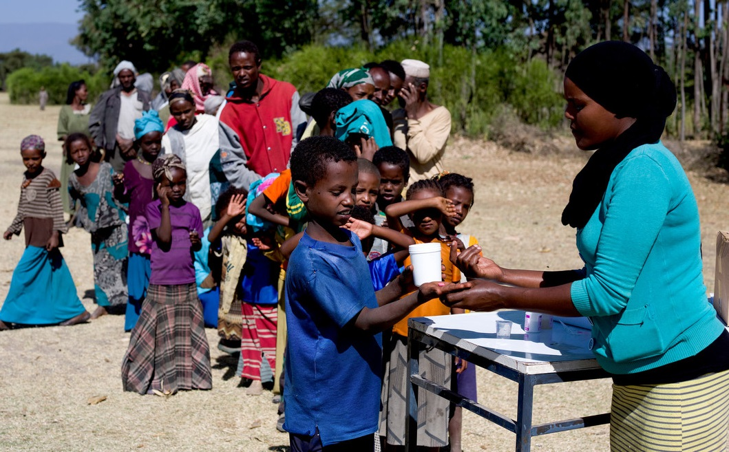 Child receiving medication to treat trachoma at a community distribution in Ethiopia