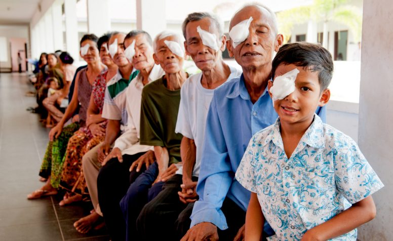 Eight-year-old Pum (pictured with his father Khum) has had cataracts since he was born, but his family didn't know that he could be treated; even if they had known, they could never have afforded the necessary surgery.  Through CBM's partner hospital however, Pum has received the sight-saving surgery he needs to get back to school.  For full story details, please see the associated document in this folder.