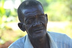 Isiko, 77, finds it difficult to work and support his children's education because of the constant pain and vision problems caused by Trachoma Trichiasis.