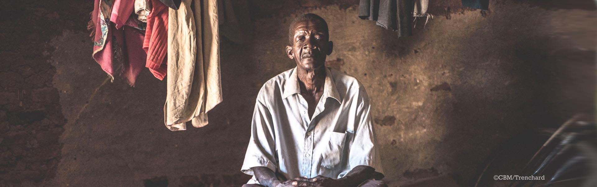 Isiko, 77, finds it difficult to work and support his children's education because of the constant pain and vision problems caused by Trachoma Trichiasis. Isiko, 77, finds it difficult to work and support his children's education because of the constant pain and vision problems caused by Trachoma Trichiasis.
