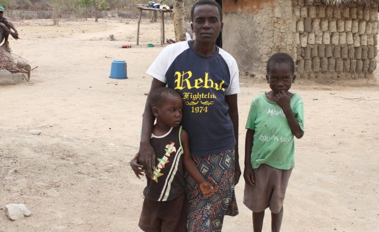 Regina Lagton, who has a physical disability, and her two children outside their home.