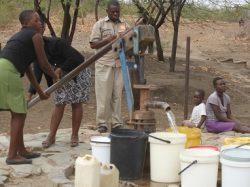 Woman at a bore hole, Zimbabwe