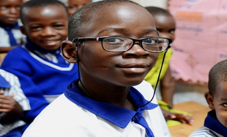 Charles with his new pair of glasses at school.