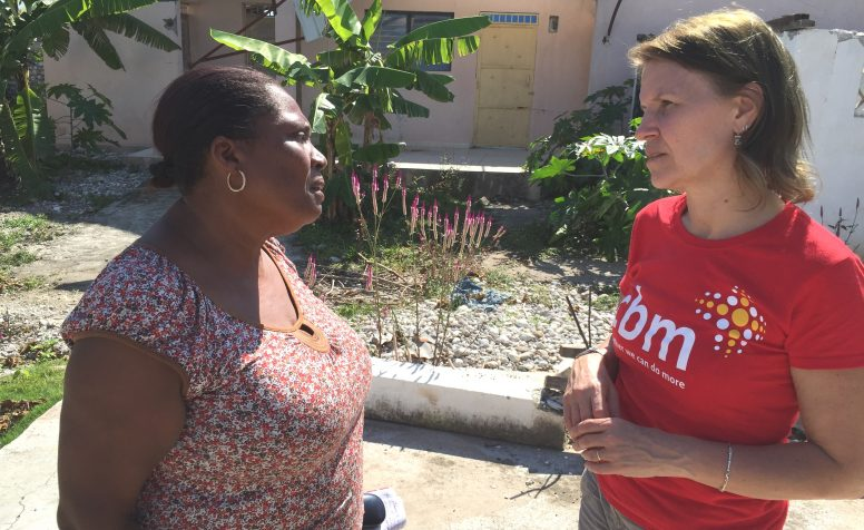 CEO Kirsty Smith in Haiti talking to Marie from our local L'Arche project helping children with disabilities.