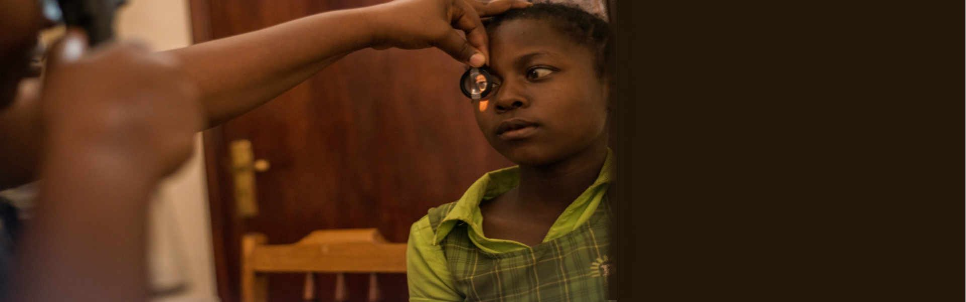 Vision therapist examines 15 year old Christine's eyes