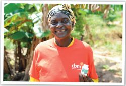 Madleine, Community Outreach volunteer in DRC administering Mectizan