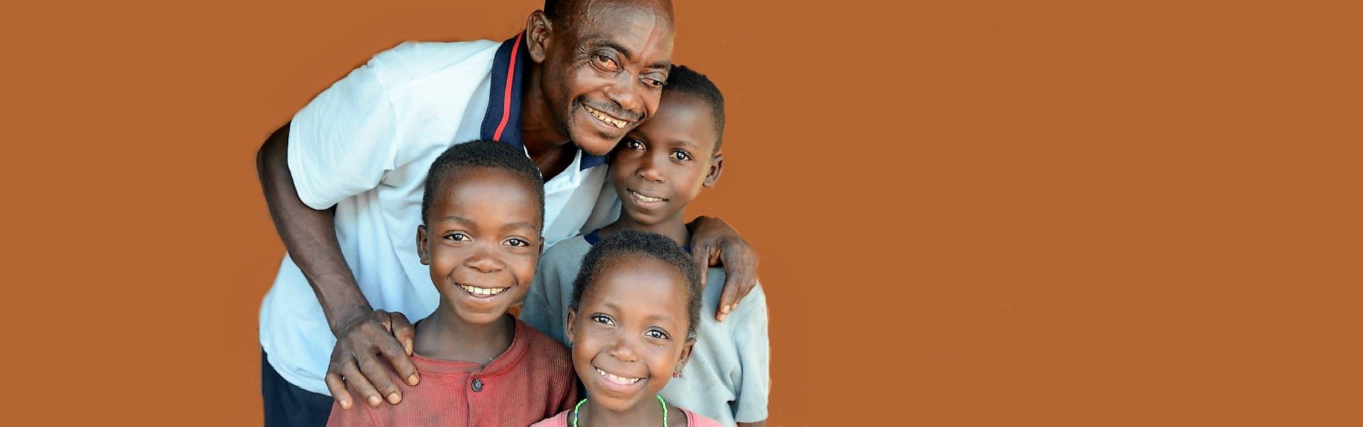 Vincent who suffers from River Blindness with his children.