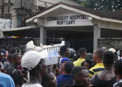 People crowd outside the Connaught Hospital mortuary