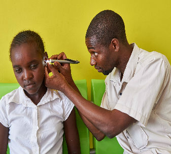 10 year-old Lushomo from Zambia, can't hear and speak. She is being treated by Dr. Uta Fröschl