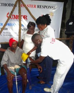Jalloh is treated at health care booth run by CBM's partner.