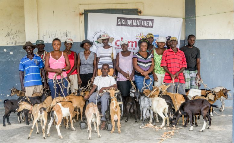 People with disabilities who lost their livelihoods as a result of Hurricane Matthew receive goats