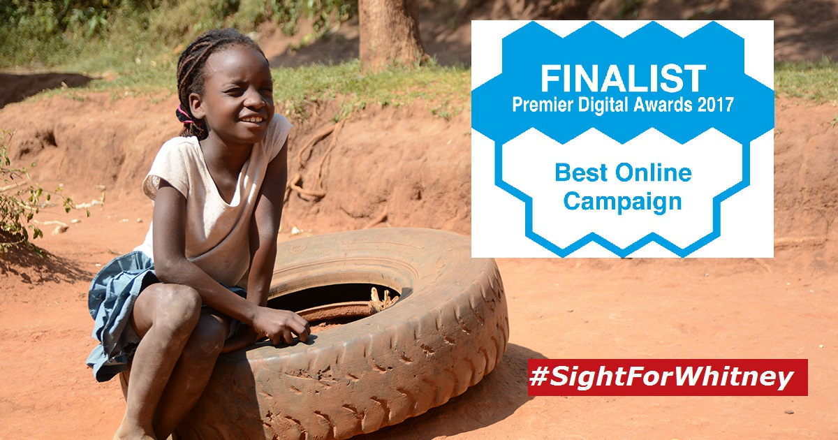 Whitney sits on tyre with eyes clothes - Logo: Premier Finalist, Best Online Campaign