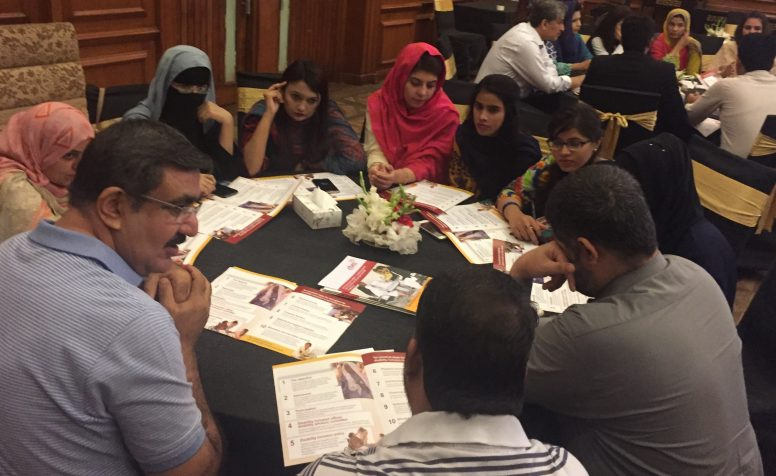 Students and eye health professionals discussing inclusive eye health in groups