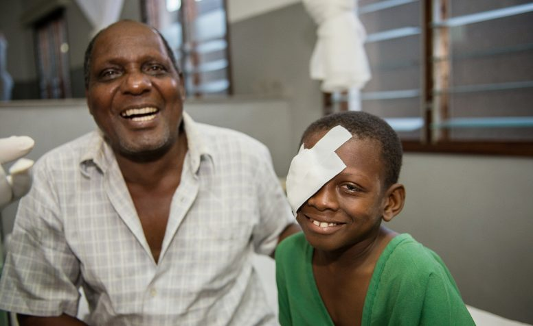 Omari cannot stop smiling after his successful cataract surgery, at a CBM partner hospital in Tanzania, East Africa.