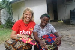 Kirsty meeting of the women living with fistula who is being helped by CBM's local partner in Tanzania.