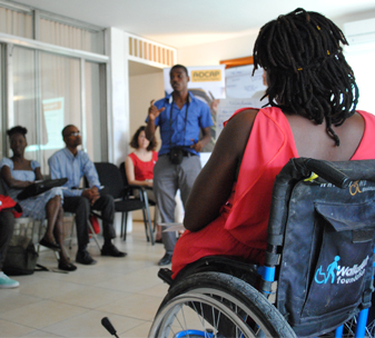Representatives of disabled people's organisations attend a training session.