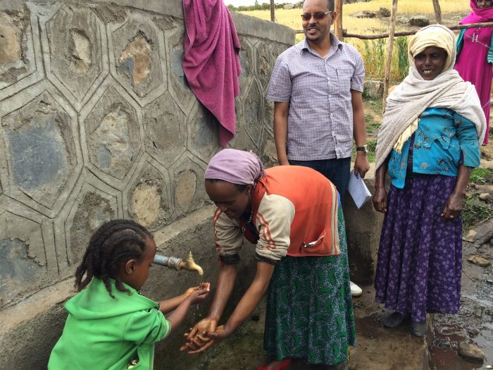 Kemila (age 23) washing her hands with her daughter (Ikeram, age 6) at the new water supply
