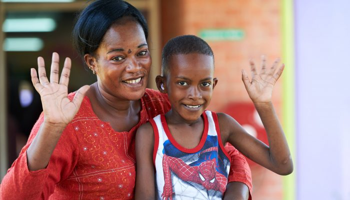 Mohamed and his mother Agness are happy after he has had an operation for a chronic ear infection at one of CBM's partner hospitals in Zambia.