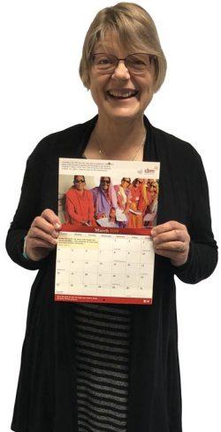 Jacquie, Community Fundraising Officer at CBM UK, holding 2018 Calendar.