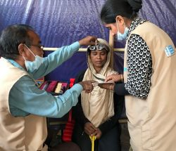 Rasheda is being fitted with glasses at the CBM clinic in Bangladesh.