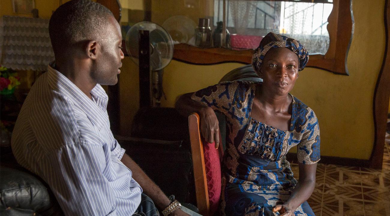 Mental health nurse Sahr Mortatay Momoh (left) visits a patient at home.