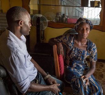 Mental health nurse Sahr Mortatay Momoh (left) visits a patient at home.